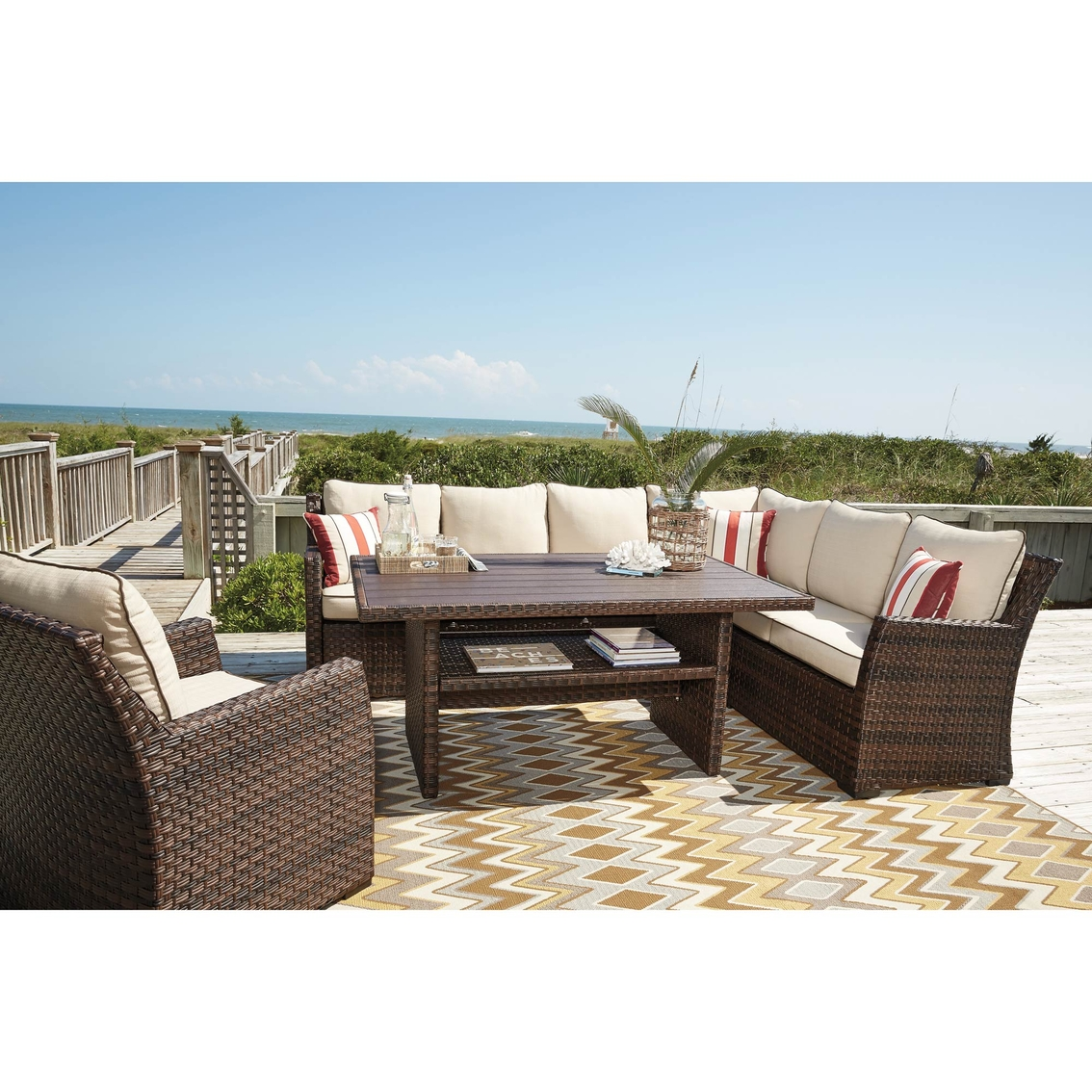 Ashley Salceda Outdoor Sectional Lounge Chair And Dining Table Set